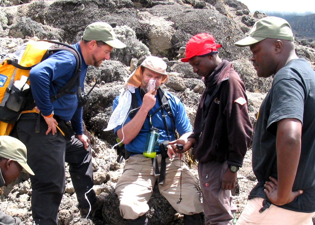 Tusker Trail Guides administering oxygen on Kilimanjaro
