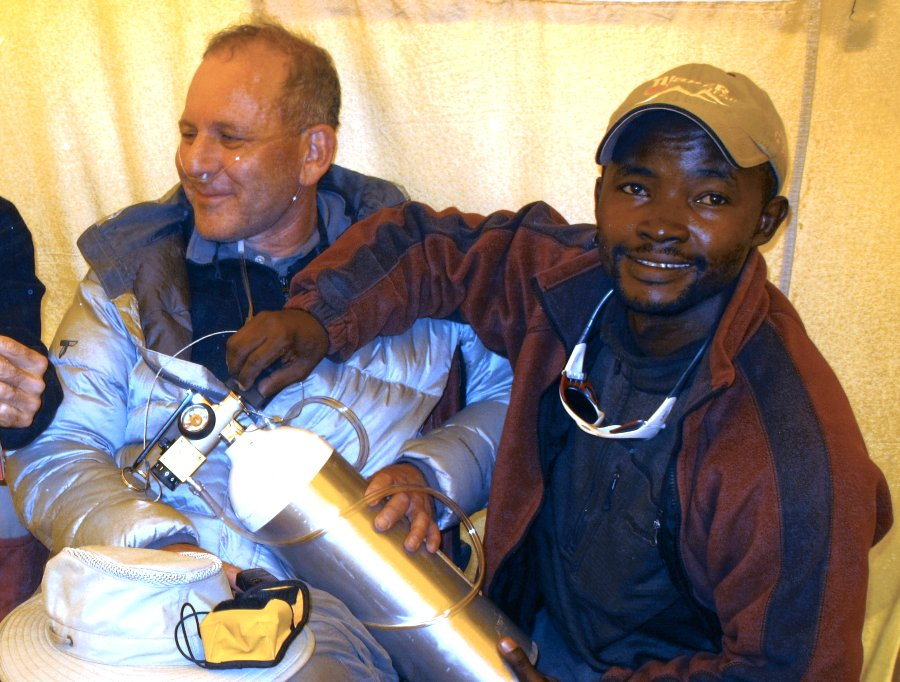 Tusker guide administering oxygen on Kilimanjaro
