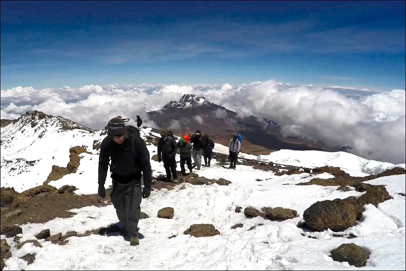 kilimanjaro climbers hiking up snow